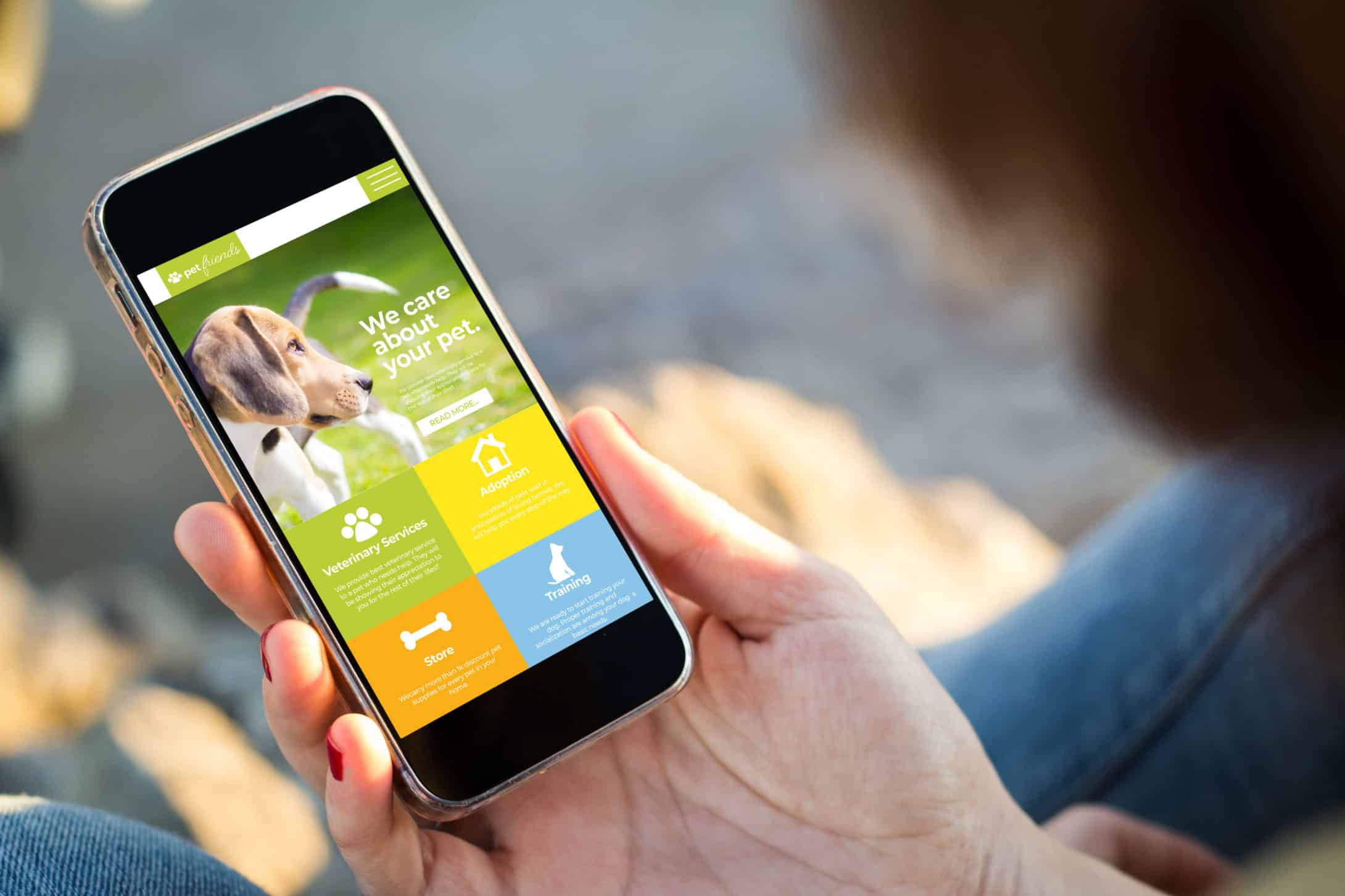 woman looking at pet friends homepage website design on her mobile phone