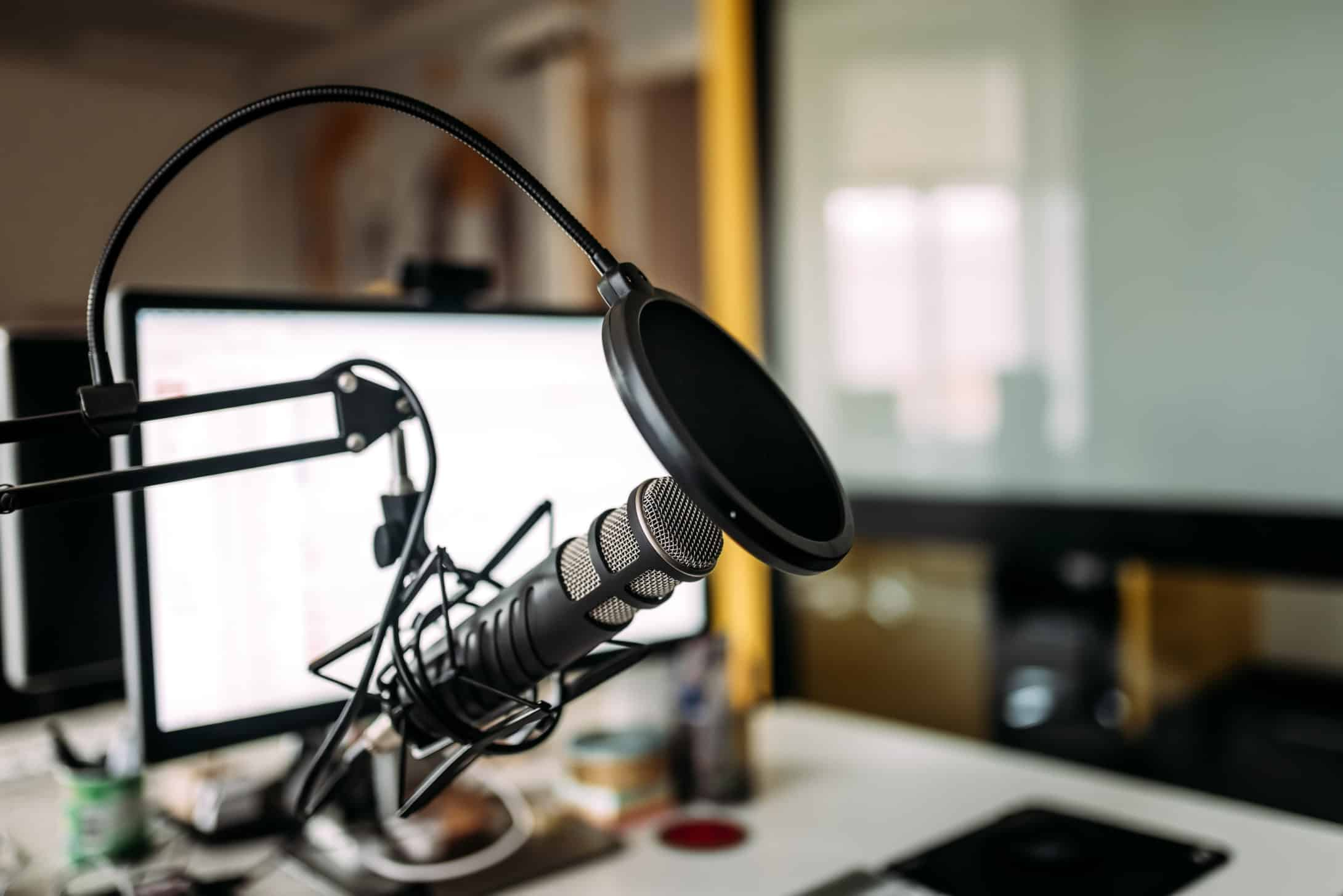 Podcast studio with microphone and computer